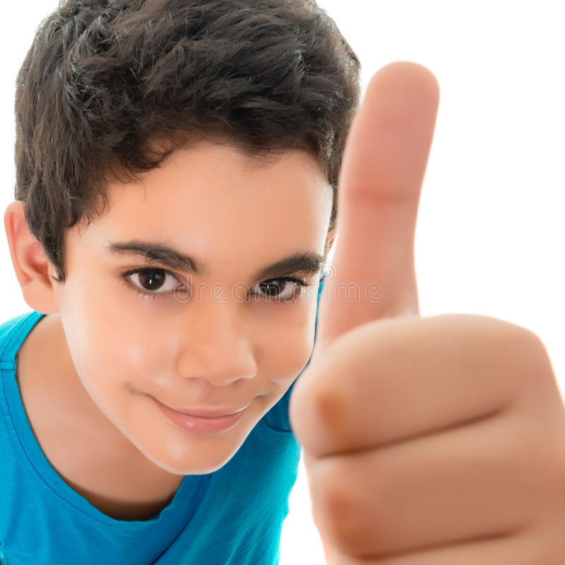 Funny small hispanic boy doing a thumbs up sign royalty free stock photography