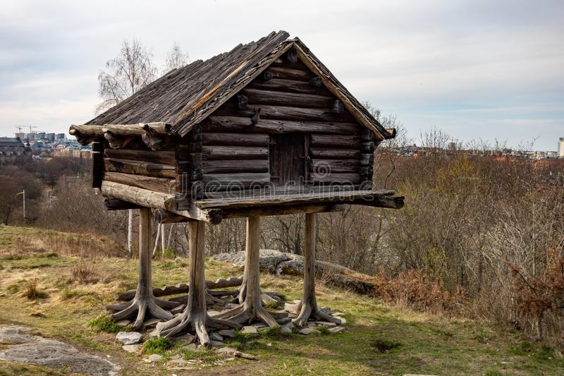 The funny small hut or storehouse built by Sami people on a high planks in Swedish Skansen stock photos