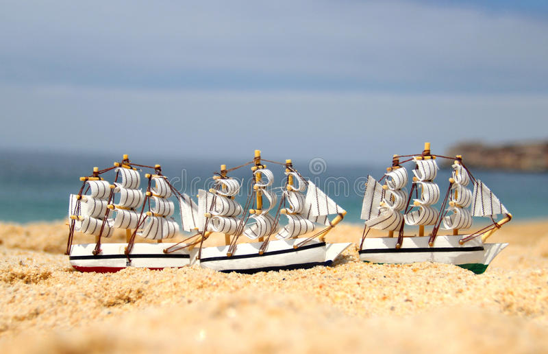 Download Funny Small Toy Sailing Ships On The Beach Stock Photo - Image of sail, play: 26302444