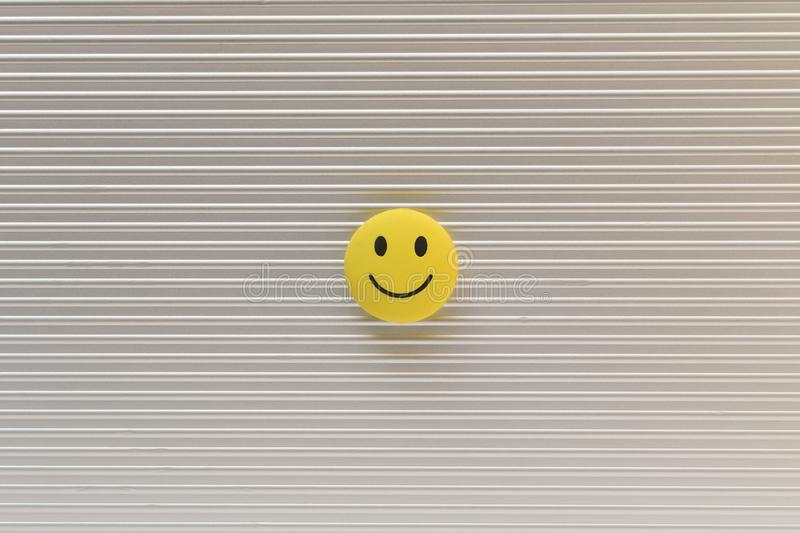 Funny smiley face on silver background. Positive mood concept.  royalty free stock images