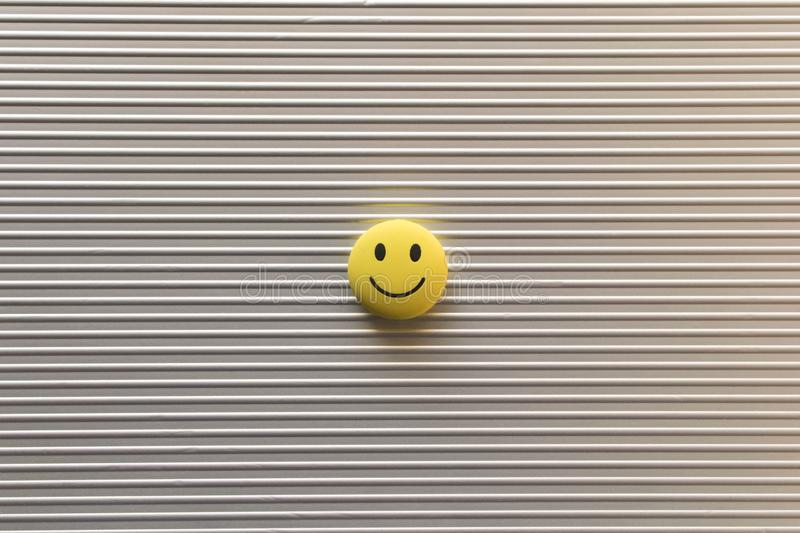 Funny smiley face on silver background. Positive mood concept.  stock photo