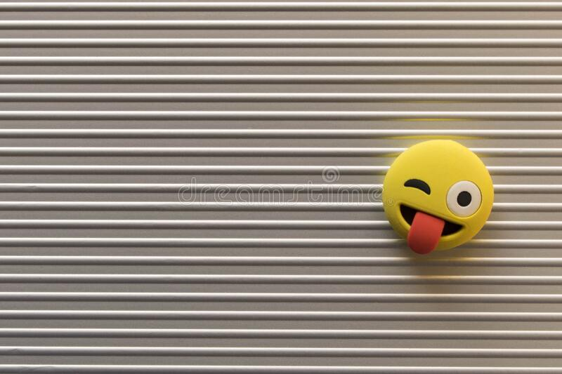 Funny smiley face on silver background. Positive mood concept.  stock photos