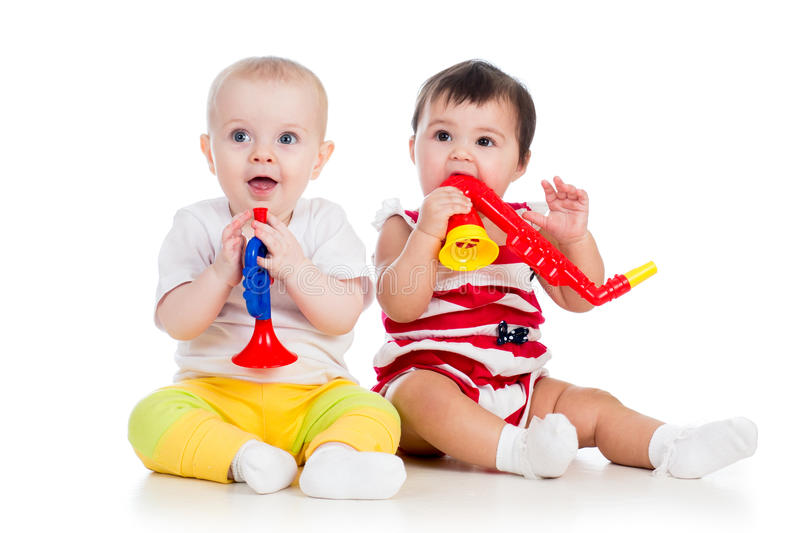 Funny smiling babies girls with musical toys stock photography