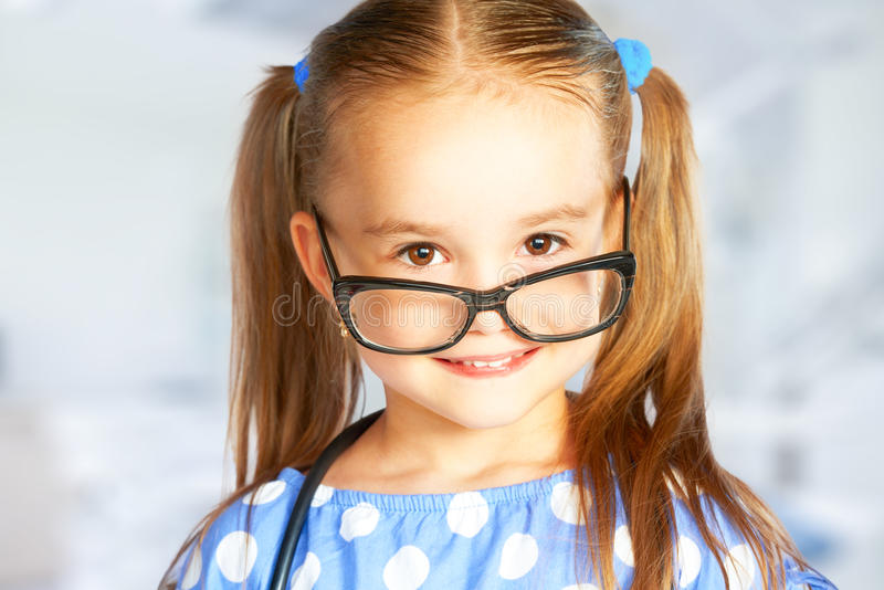 Funny smiling child girl in glasses royalty free stock images