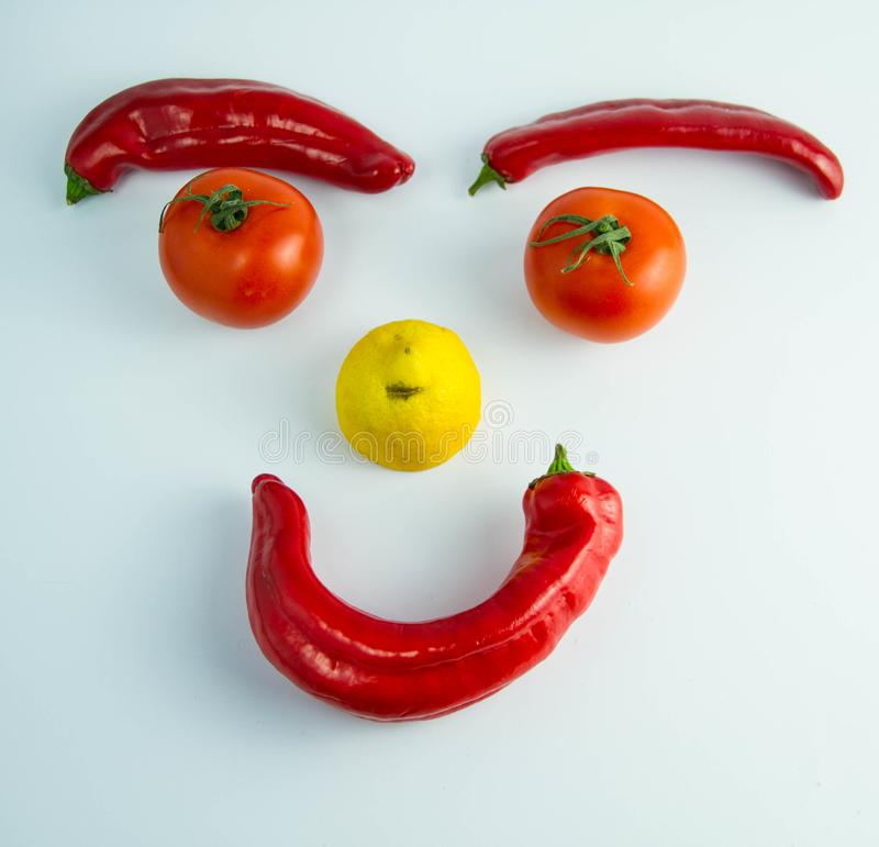 A funny smiling emoticon made of vegetables royalty free stock photos
