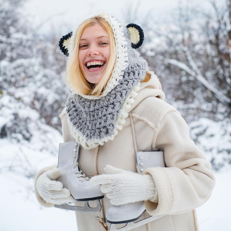 Funny smiling Model Girl laughing and having fun in winter park. Beautiful happy laughing young woman wearing winter hat royalty free stock image