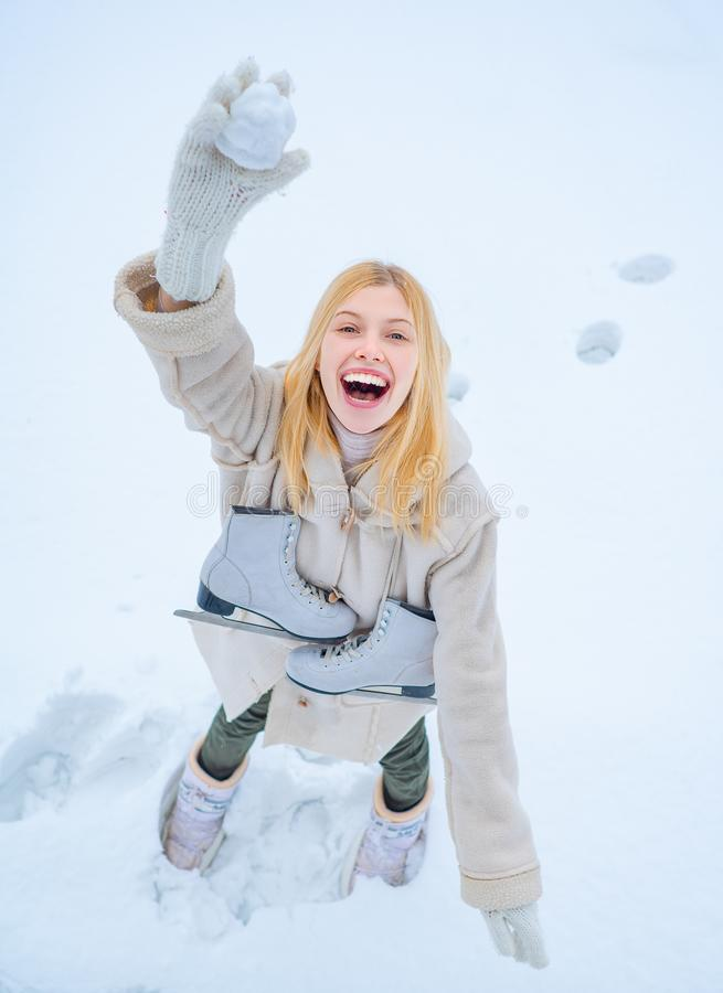 Funny smiling young woman in wintertime outdoor. Wearing funny hat plaid scarf and coat. Happy winter fun woman. Winter stock images