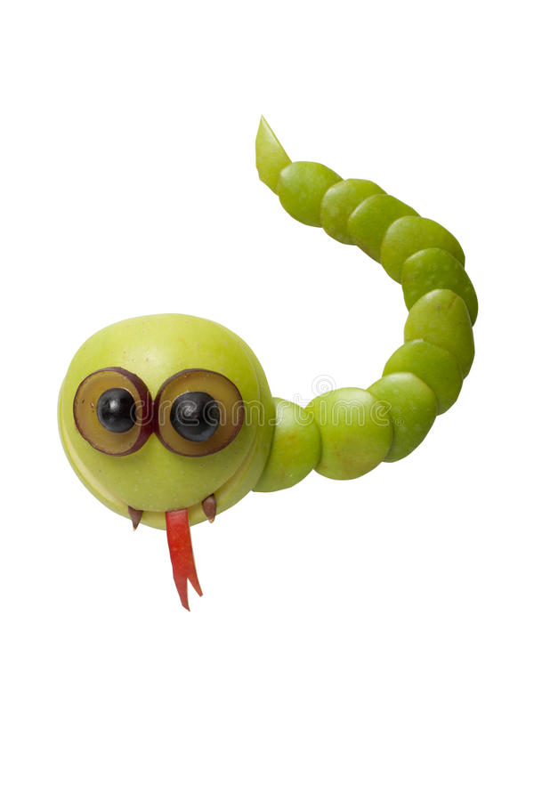 Funny snake made of green fruits stock photos