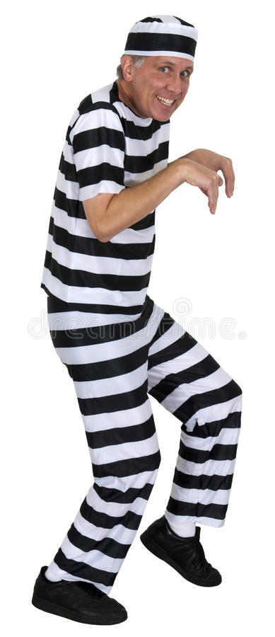 Funny Sneaking Convict Burglar Isolated on White. Funny sneaking convict humor. This burglar thinks he can sneak away. Stop! Thief! Isolated on white royalty free stock image