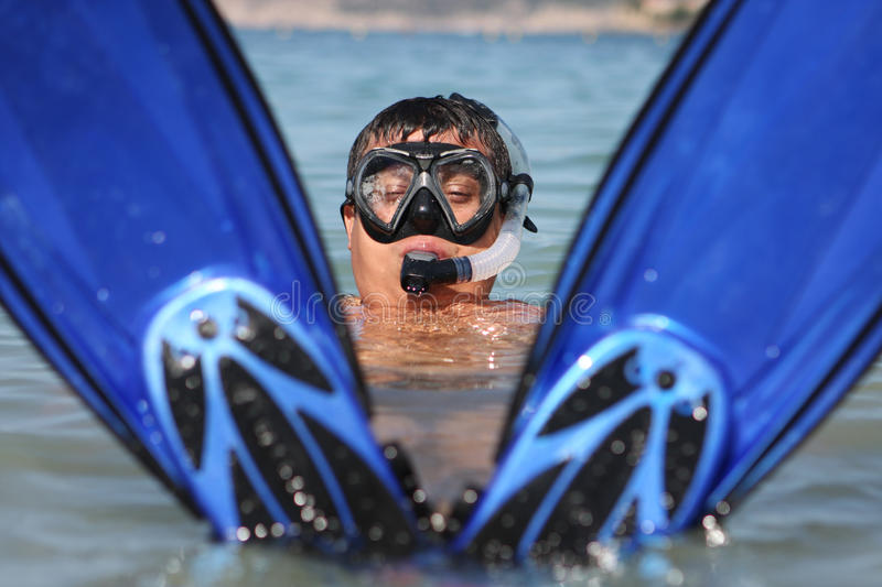 Funny snorkel man. In the sea stock image
