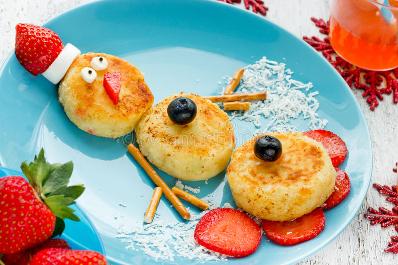 Funny snowman Christmas morning breakfast pancakes for kid. S stock image