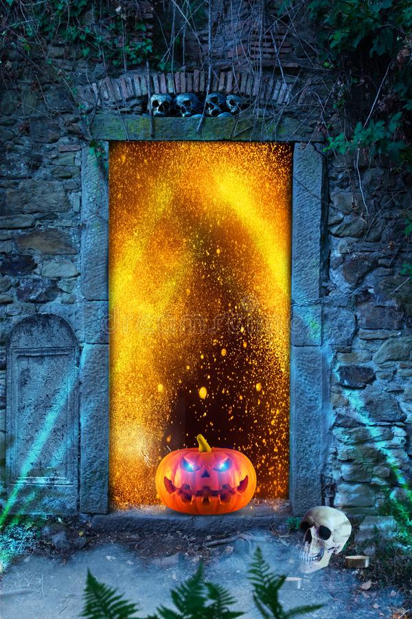 Funny spooky halloween pumpkin with spider, skulls and candles in front of the hell`s door.. stock photography