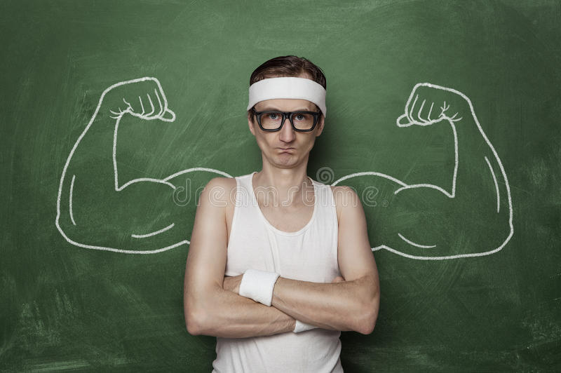 Funny sport nerd. With fake muscle drawn on the chalkboard stock photography