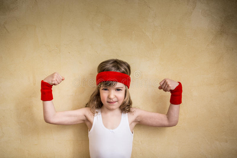 Funny strong child. Girl power and feminism concept royalty free stock photography