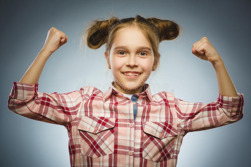 Funny Strong serious girl showing his hand biceps muscles royalty free stock photo