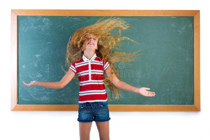 Funny student girl flipping long hair at school royalty free stock photography