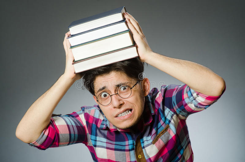 Funny student with many books royalty free stock photo
