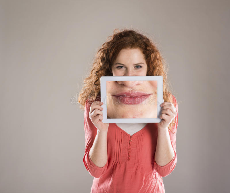 Funny portraits. Funny studio portraits with tablet on isolated background royalty free stock images