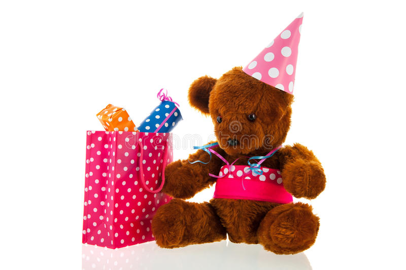 Funny stuffed bear with gifts. Funny stuffed bear with colorful birthday gifts isolated over white background royalty free stock image