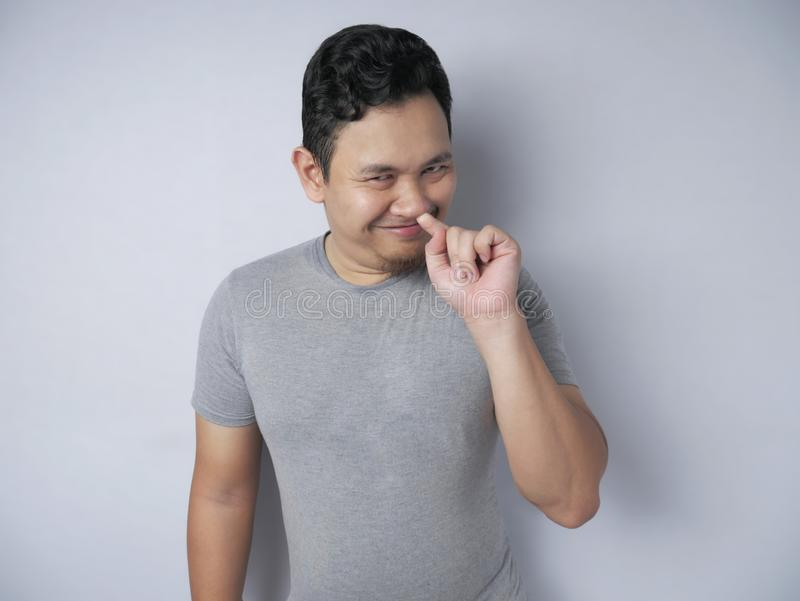 Funny Stupid Man Picking Nose While Smiling to Camera royalty free stock photography