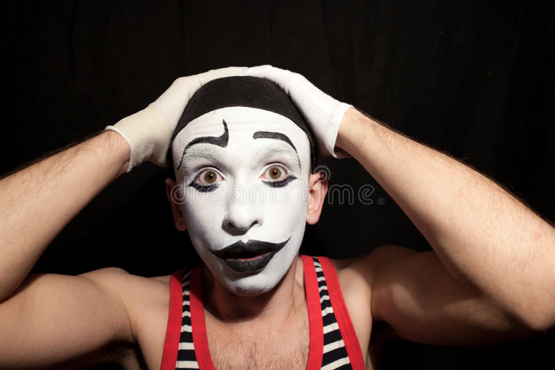 Funny stupid mime grabbed his head royalty free stock photos