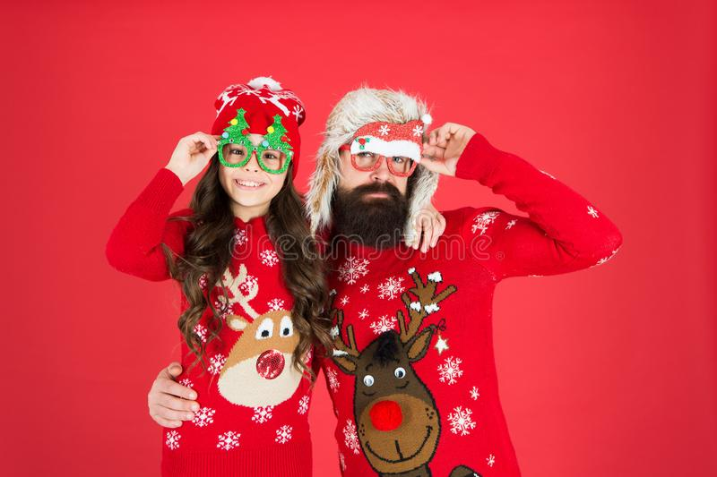 Funny style. Happy family. Small girl and cheerful father man. Family values. Family wear winter sweaters. Having fun stock photography