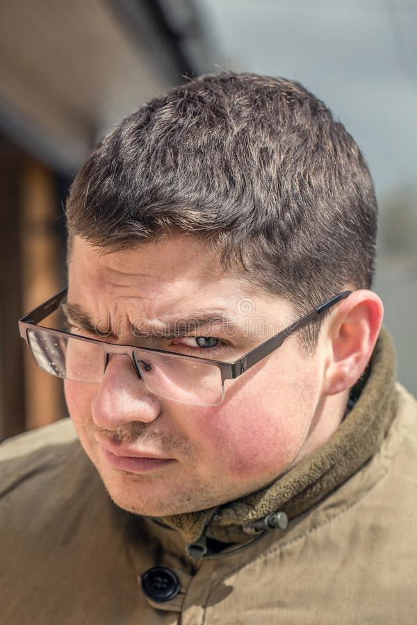 Funny surprised guy with glasses stock photos