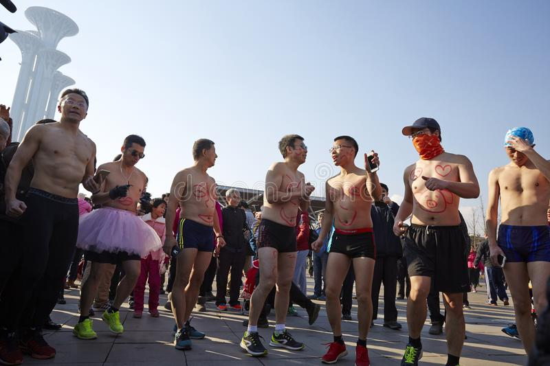 Color run team without clothes. Funny team in discussion, planning for running in winter, Beijing Olympic park stock photos