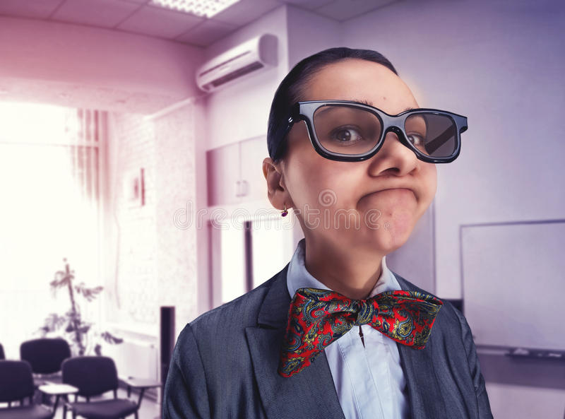 Funny thoughtful nerd girl royalty free stock photos