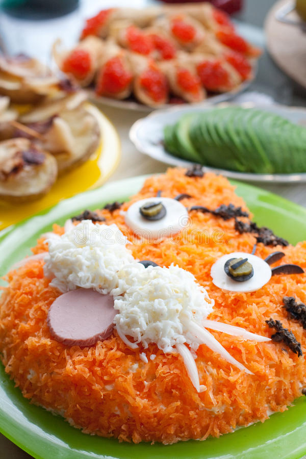 Funny tiger face. A funny tiger face composition made of food stock photography