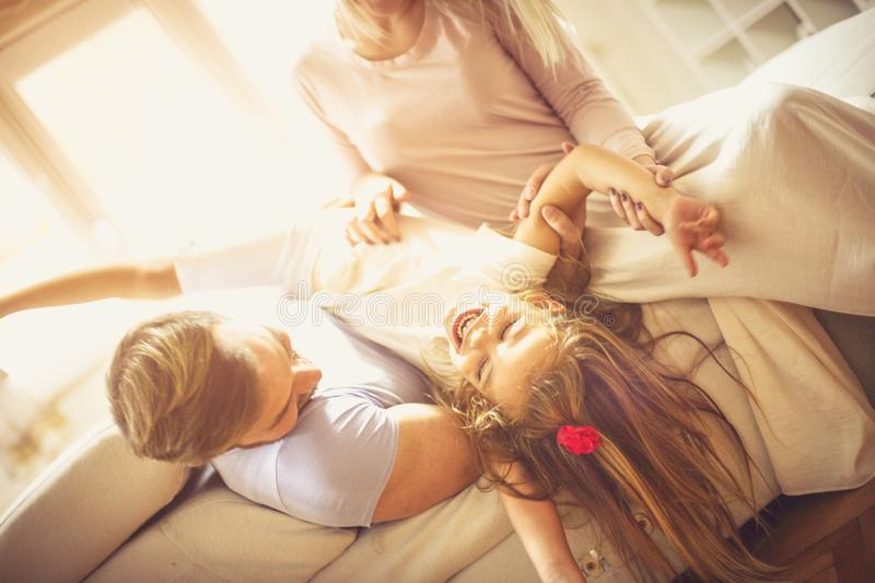 Funny time. Happy family playing at home. Close up stock photography