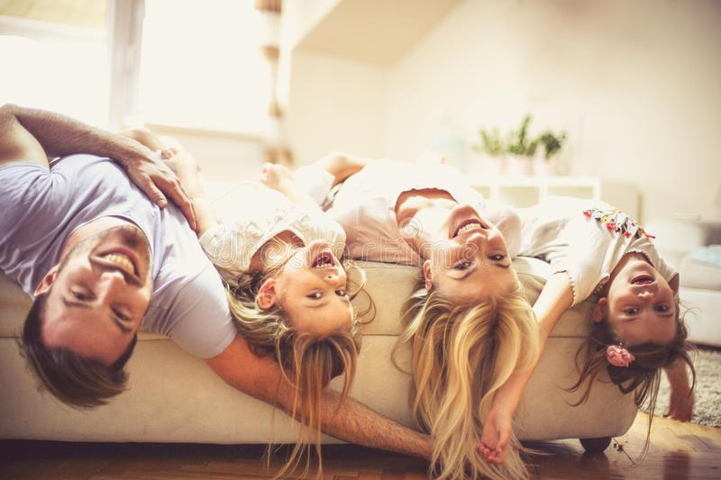 Funny time. Happy family on bed. Close up royalty free stock photo