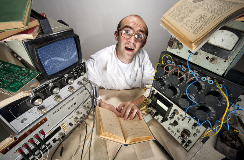Funny timid scientist reading book royalty free stock photo