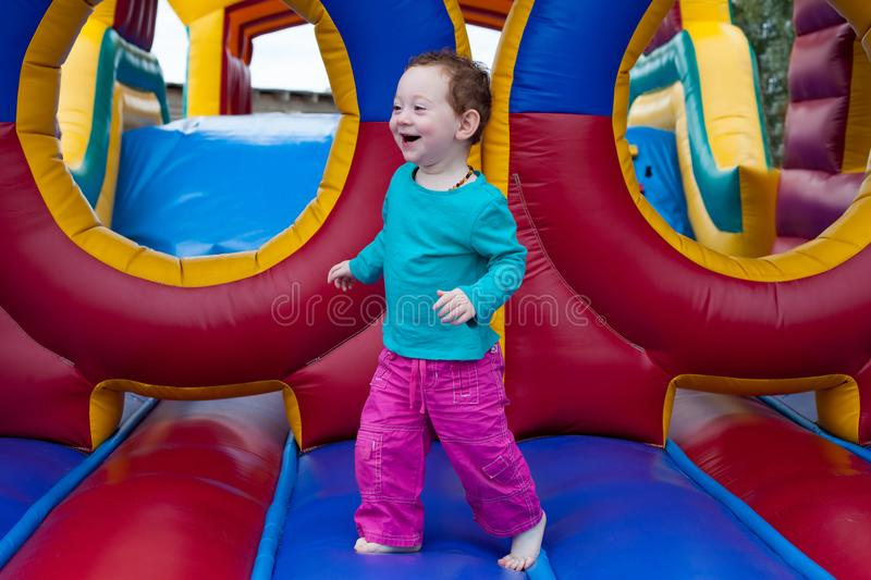 Funny toddler run on trampoline royalty free stock photography