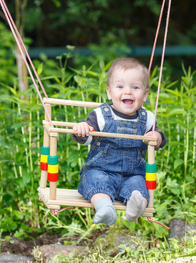 Funny toddler swinging royalty free stock photos