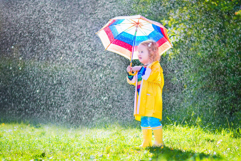 Funny Toddler With Umbrella Playing In The Rain Stock ...