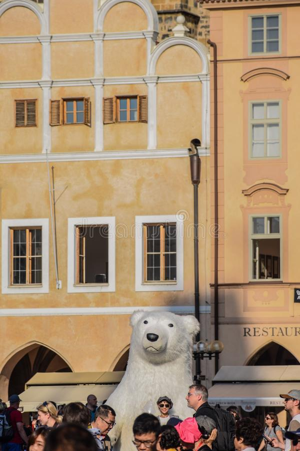 Prague, Czech Republic - September , 17, 2019: Funny tourist photographed with a giant inflatable polar bear in the Old stock photography