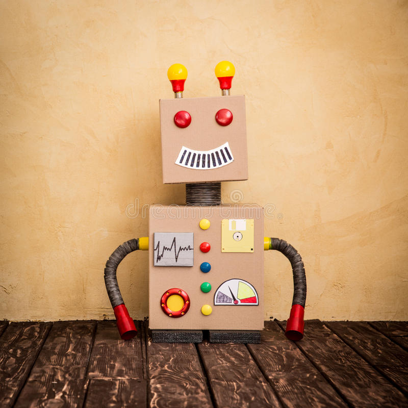 Funny toy robot. Innovation technology and creative concept stock photos