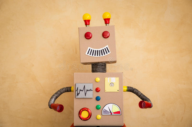 Funny toy robot. Innovation technology and creative concept stock image