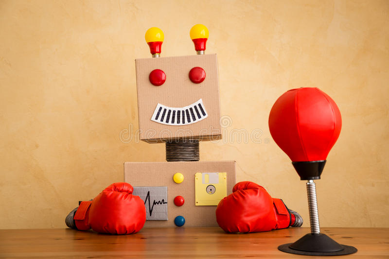 Funny toy robot. Innovation technology and creative concept stock photography