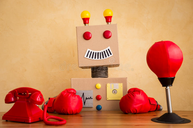 Funny toy robot. Innovation technology and creative concept stock images