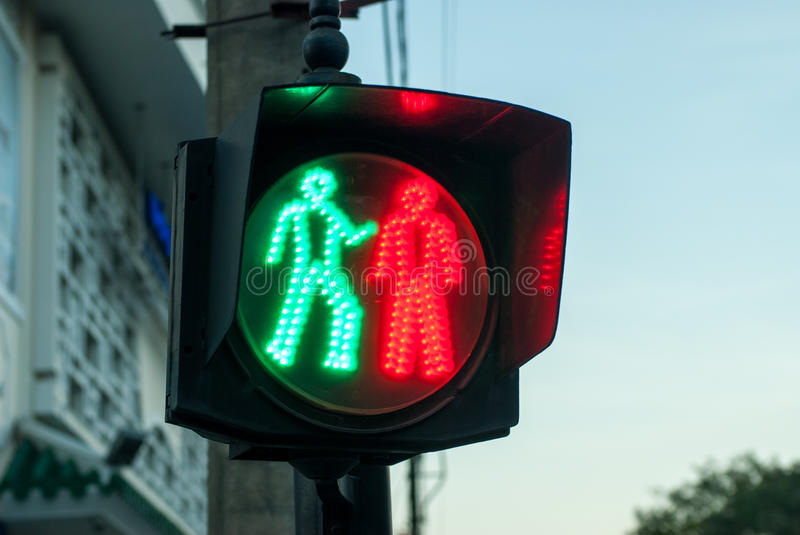 Funny traffic light in Hue, Vietnam. Looks a bit like they are fighting royalty free stock photo