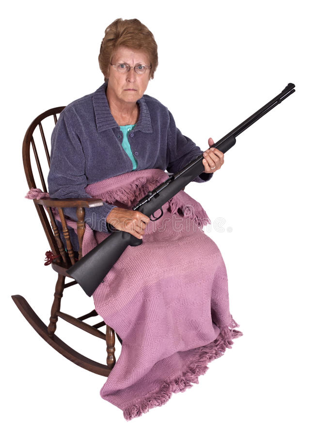 Funny Trailer Park Trash Granny with Gun Humor. Funny granny in her rocking chair while holding a gun. This grandma and mature senior woman was raised as trailer stock photo