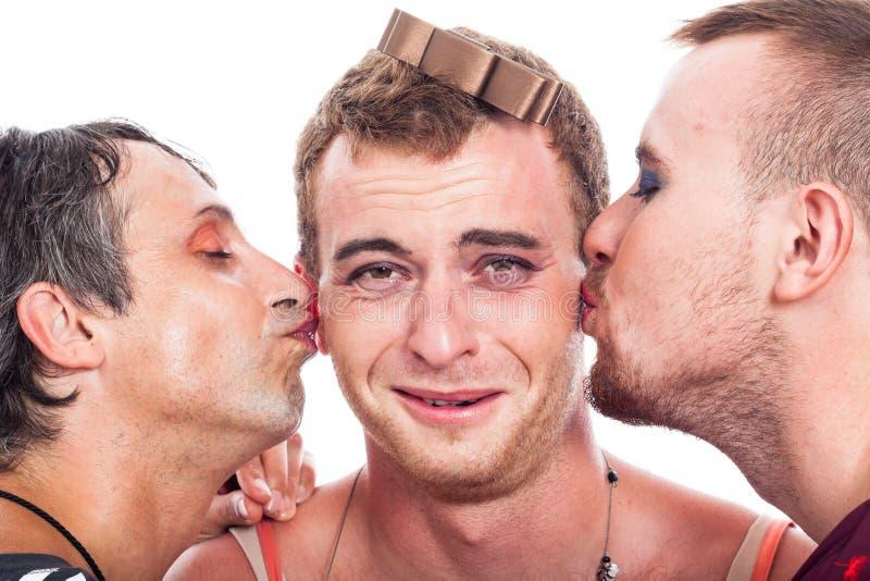 Funny transvestites kiss stock photography