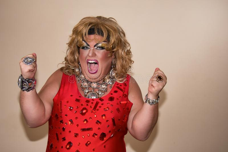 Funny travesty actor. Drag queen in red. Feelings and emotions. Funny travesty actor. Drag queen. Fat man and make-up royalty free stock photo