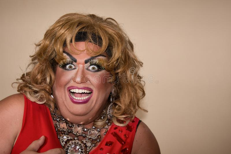 Funny travesty actor. Drag queen in red. Feelings and emotions. Funny travesty actor. Drag queen. Fat man and make-up royalty free stock photography