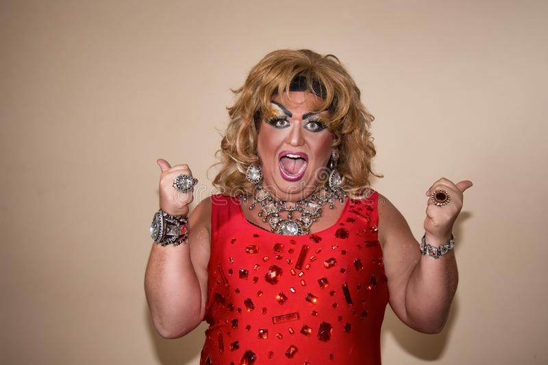 Funny travesty actor. Drag queen in red. Feelings and emotions. Funny travesty actor. Drag queen. Fat man and make-up royalty free stock photos