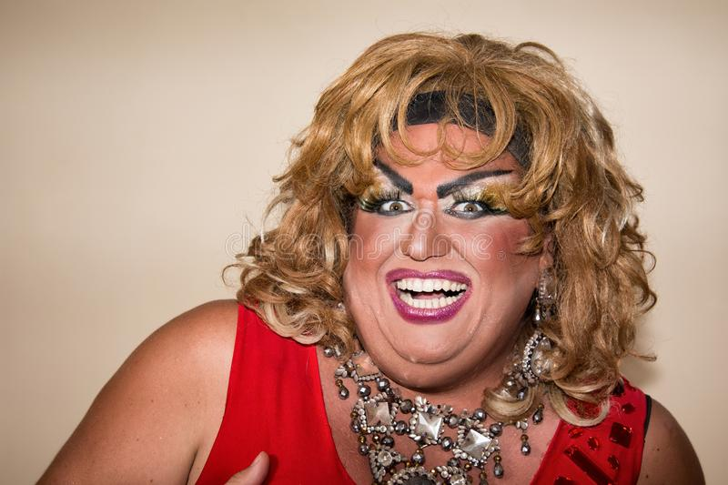 Funny travesty actor. Drag queen in red. Feelings and emotions. Funny travesty actor. Drag queen. Fat man and make-up royalty free stock images