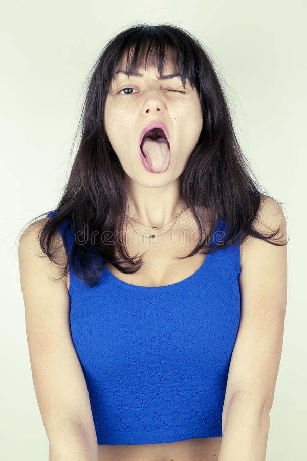 Funny Ugly Girl Portrait. Funny ugly humor girl portrait put out tongue royalty free stock images