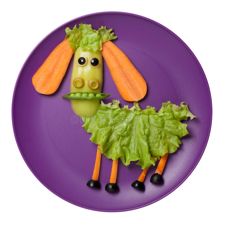 Funny vegetable sheep made on purple plate stock photos